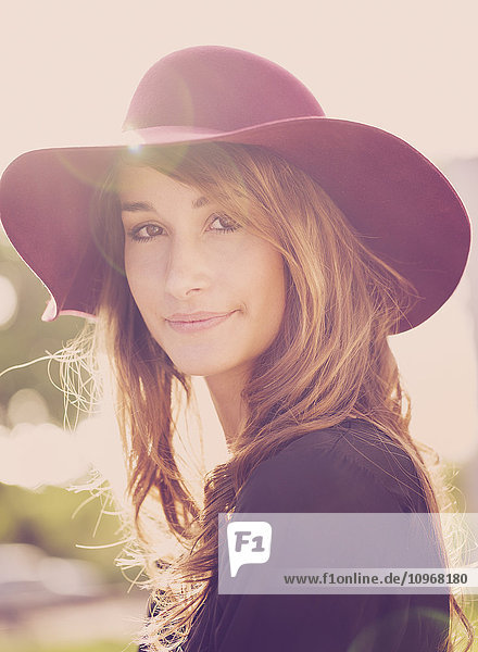 Fashion portrait of young beautiful woman in hat  bright warm sunny colors