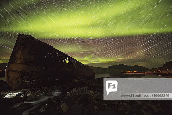 'Star trails and northern lights over top the town of Djupavik in the West Fjords of Iceland; Djupavik  Iceland'