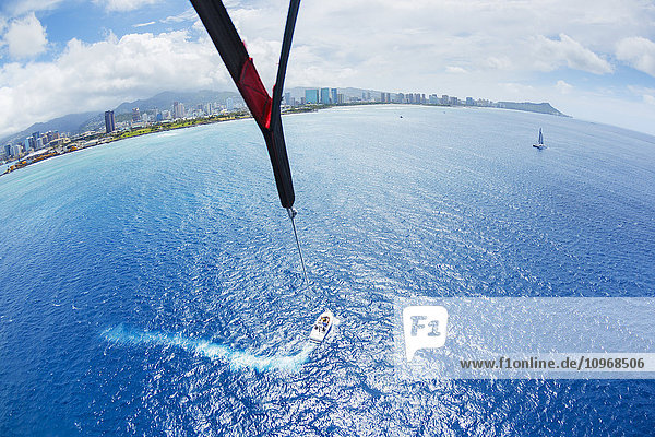 Parasailing Over Ocean in Hawaii  View from up in the Sky