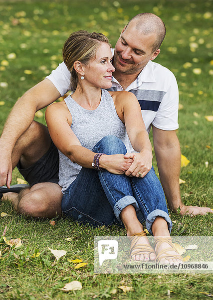 'A married couple spending quality time together in a park; Edmonton  Alberta  Canada'