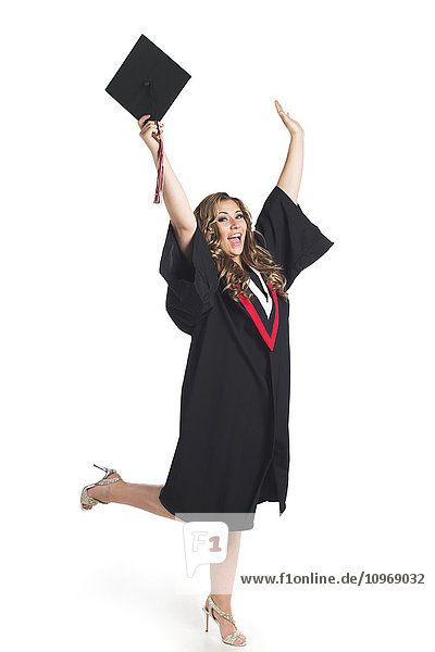 'Young woman holding her hands up in celebration of her graduation; Edmonton  Alberta  Canada'