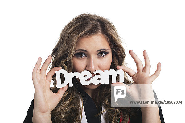 'Young woman dreaming about her future now that she has graduated; Edmonton  Alberta  Canada'
