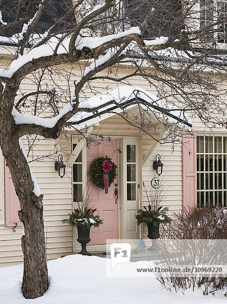 'Christmas wreath on front door of house; Knowlton  Quebec  Canada'