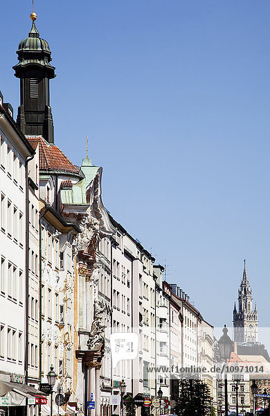 'Buildings in a row with towers along the skyline; Munich  Bavaria  Germany'