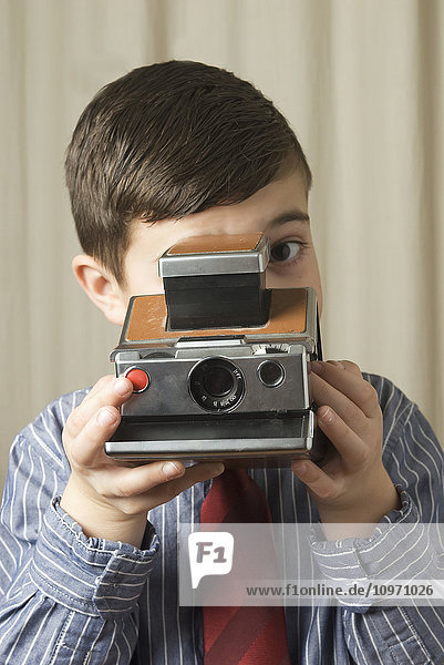 'Young Boy With Old Polaroid Instant Camera; Laval  Quebec  Canada'