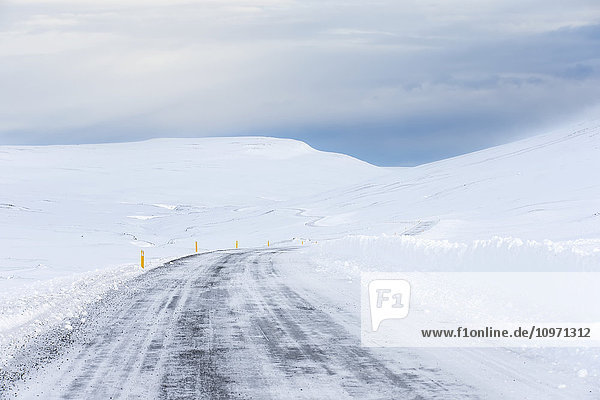 'Highway Weaving Through The Snowy Landscape; Northern Iceland'