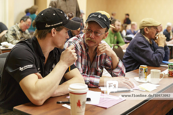 Father and son mushers  Dallas and Mitch Seavey  at the 2015 Iditarod musher meeting  Anchorage  Southcentral Alaska