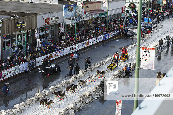 Mitch Seavey leaves the start line on 4th avenue during the cermonial start day of Iditarod 2015 in Anchorage  Alaska
