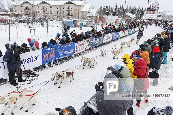 Jim Lanier runs down the start chute at the official start of the 2015 Iditarod in Fairbanks  Alaska.
