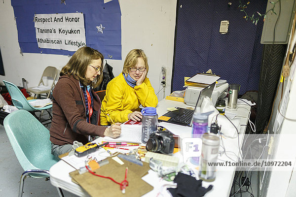 Comms volunteers working at the Tanana checkpoint during Iditarod 2015