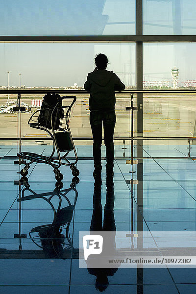 'Silhouette of traveller at Barcelona Airport; Barcelona  Spain'