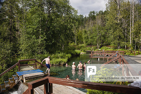 Tourists in the pools of Liard River Hot Springs  British Columbia  Canada