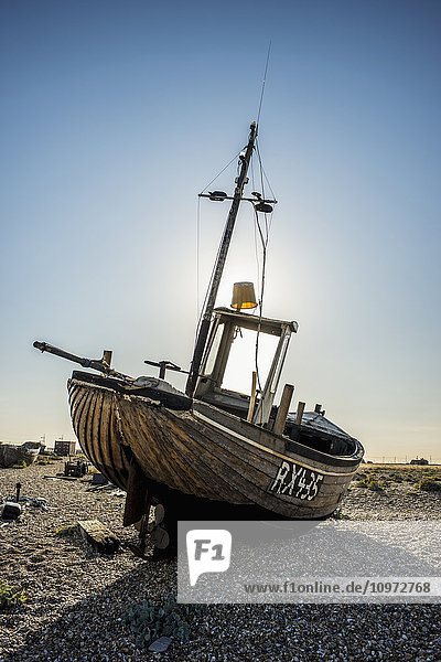 'Old boat on a shingle beach; Dungeness  Kent  England'