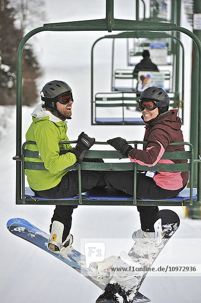 Couple ride the chair lift at Hilltop Ski Area in Anchorage  Alaska