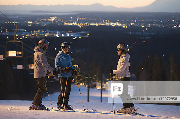 Friends at the top of Hilltop Ski Area at sunset in Anchorage  Alaska