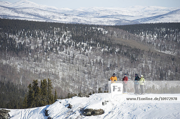 Friends take in the view during a day of downhill skiing at Mt. Aurora Skiland near Cleary Summit north of Fairbanks  Alaska