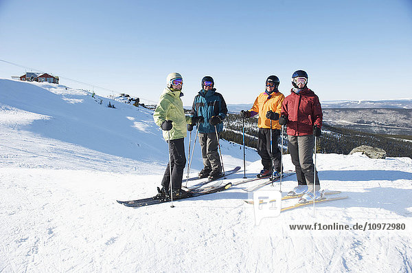 Friends gather at the top of Mt. Aurora Skiland for a day of downhill skiing near Cleary Summit north of Fairbanks  Alaska