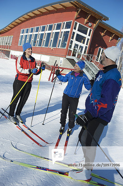 Friends gather outside the Birch Hill Nordic Ski Center  Birch Hill Recreation Area in Fairbanks  Alaska