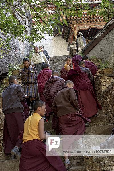 'Monks and pedestrians on steps  Taktsang trail; Paro  Bhutan'