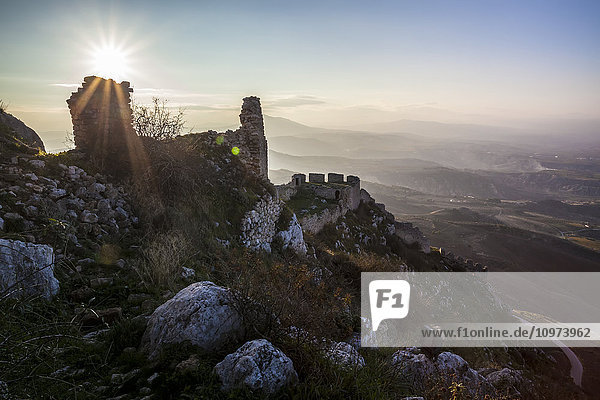 'Ruins of a stone building and sunburst; Corinth  Greece' 'Ruins of a stone building and sunburst; Corinth, Greece'