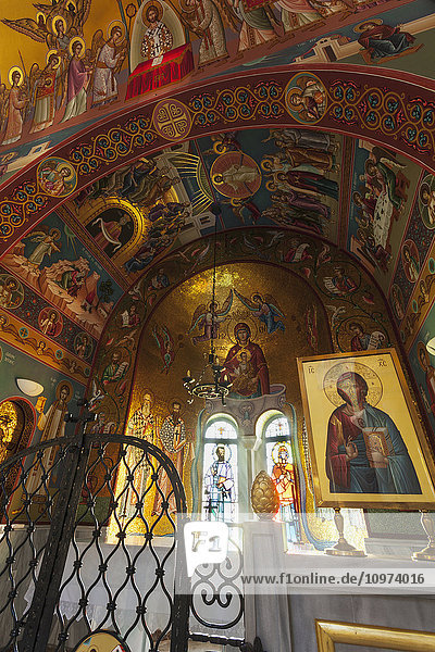 'Colourful paintings of religious figures in an arch in a church; Philippi  Greece' 'Colourful paintings of religious figures in an arch in a church; Philippi, Greece'