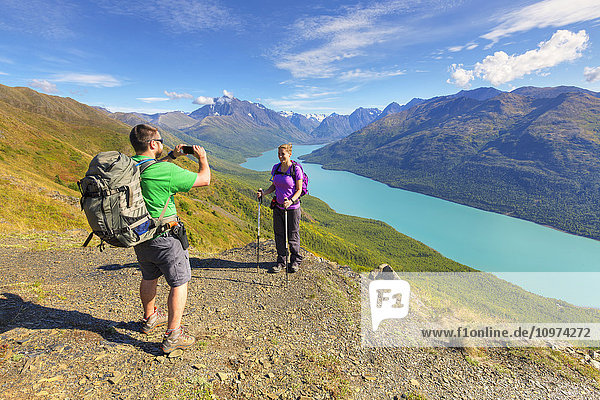 'Hikers taking pictures along the Twin Peaks Trail,  Eklutna Lake,  Chugach State Park,  Southcentral Alaska,  Summer'