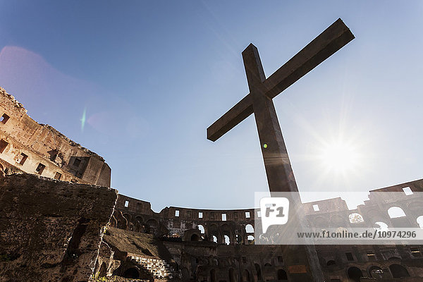 'Cross in the Colosseum; Rome  Italy' 'Cross in the Colosseum; Rome, Italy'