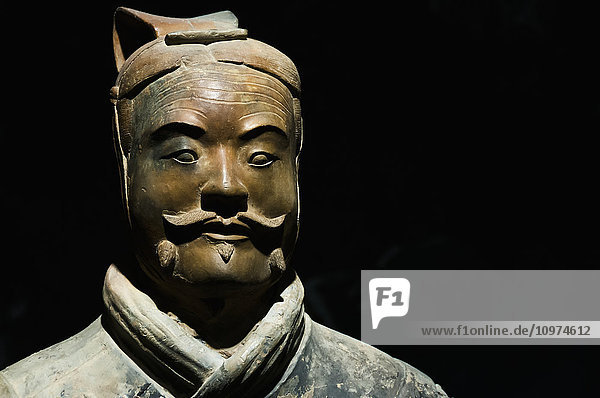'One of Xian´s Terracota Warriors  a collection of terracotta sculptures depicting the armies of Qin Shi Huang  the first Emperor of China; Xian  Shaanxi province  China'