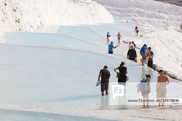 'Tourist at the mineral rich pools and hot springs; Pamukkale  Turkey'