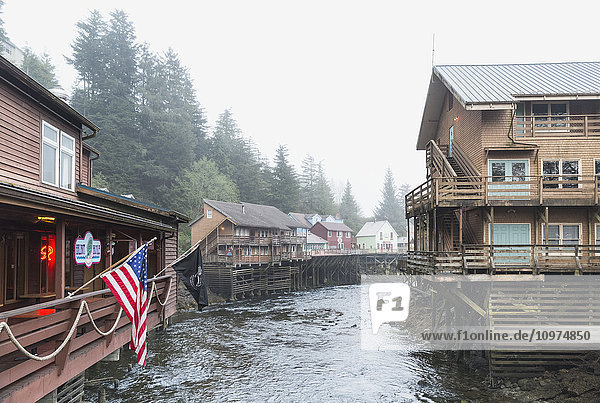 Tourist shops and homes along Creek Street in downtown Ketchikan  Southeast Alaska  USA  Spring