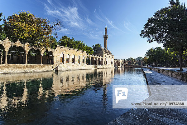 'Chamber of Abraham and a minaret reflected in the tranquil water of a lake; Sanliurfa  Turkey' 'Chamber of Abraham and a minaret reflected in the tranquil water of a lake; Sanliurfa, Turkey'