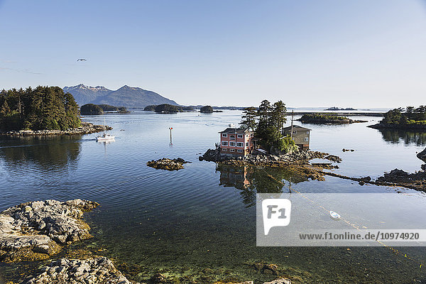 Small island with residential homes  Sitka  Southeast Alaska  Summer