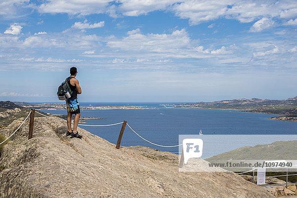 'Man enjoying the panoramic view from Capo d'Orso; Palau  Sardinia  Italy'