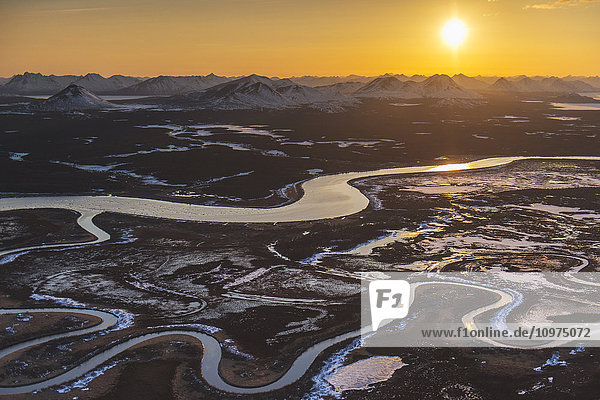 Aerial scenic of sunset on the Wood River and Nushagak River confluence with the Wood Mountains in the background near Dillingham  Southwest Alaska