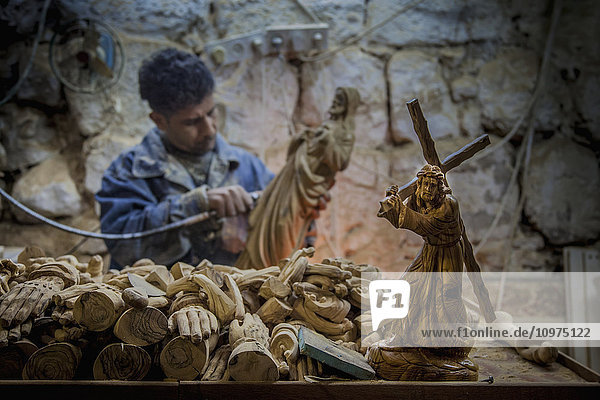 'A man hand carves figurines; Bethlehem  Jerusalem' 'A man hand carves figurines; Bethlehem, Jerusalem'