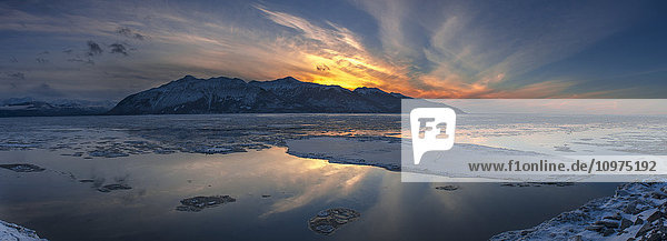 Sheets of ice being carried out with outgoing tide on Turnagain Arm at sunset  south of Anchorage  Alaska.