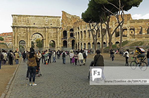 'Tourists coming and going from the Colosseum and Arch of Constantine; Rome  Italy'
