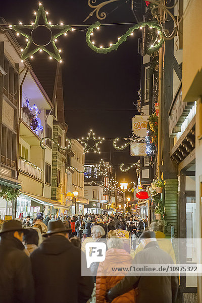 'Crowds visit the Christmas market in the heart of the old town; Altenahr  Nordrhein Westfalen  Germany'