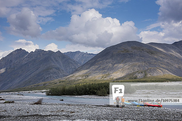 Two rafters scouting along the Marsh Fork of the Canning River in the Arctic National Wildlife Refuge  Summer  Alaska