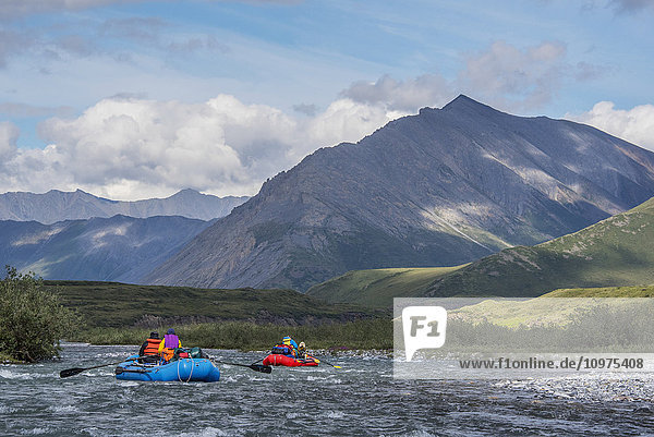 Two rafters on the Marsh Fork of the Canning River in the Arctic National Wildlife Refuge  Summer  Alaska