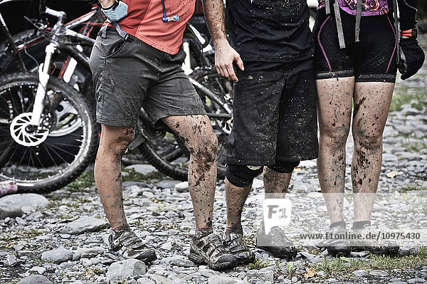 Close up of muddy mountain bikers after a long ride on the Resurrection Pass Trail  Chugach National Forest  Kenai Peninsula  Southcentral Alaska