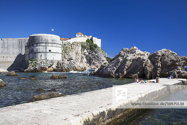 'The Walls of Dubrovnik surround the old city of Dubrovnik and provide stunning scenery and vantage points around the city; Dubrovnik  Croatia'