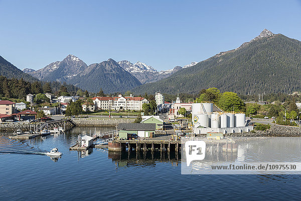 View of the pier and Sitka harbor with the Three Sisters mountains in the background  Southeast Alaska  summer