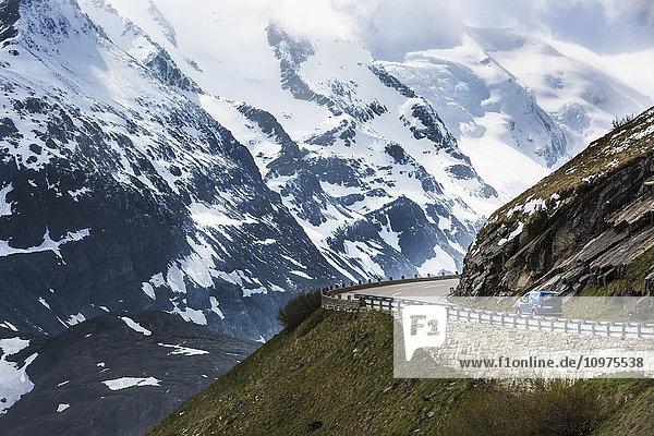 'A drive headed to the summit of Austria's highest mountain pass  the Grossglockner High Alpine Road; Untertauern  Karnten  Austria'