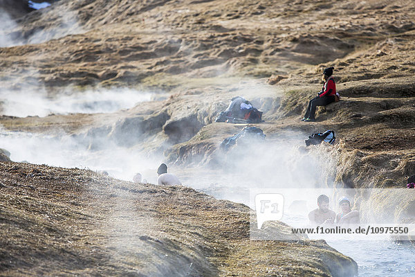'A hike through the Reykjadalur valley through thermal steam vents and boiling hot pools suitable for bathing; Reykjadalur valley  Reykjadalur  Iceland'