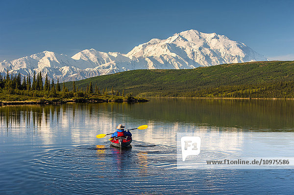A man kayaking on Wonder Lake in Denali National Park with Denali in the background  Interior Alaska  summer