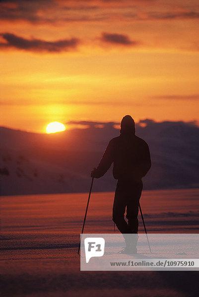 Silhouette Of Cross-Country Skier On Mount Douglas Watching Sunset In Katmai National Park Alaska