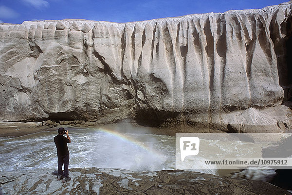 Person Views A Volcanic Ash Wall Above The Okak Waterfalls Of Lethe River In The Valley Of 10 000 Smokes  Katmai National Park  Alaska