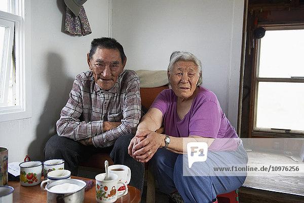 'Inuit elders in their cabin; Cambridge Bay  Victoria Island  Nunavut  Canada'