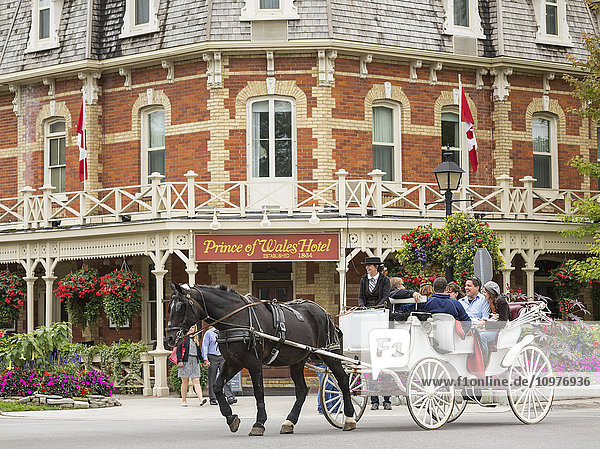 'Horse-drawn carriage in front of Prince of Wales Hotel; Niagara-on-the-Lake,  Ontario,  Canada'